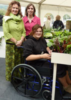 Caroline Lennon and Helen Williams garden designers. Pictured with wheelchair user.