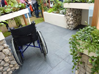 Slate floorspace showing wheelchair access and raised beds