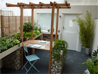 Eating / planting area with climbing plant frame and adjustable hanging basket