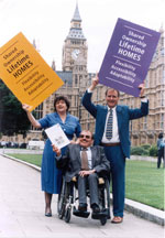 Mike Donnelly and Bert Massie campaigning for Lifetime Homes outside the Houses of Parliament