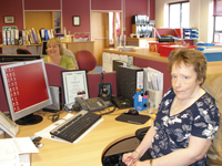 Members of Customer Service team at their desks