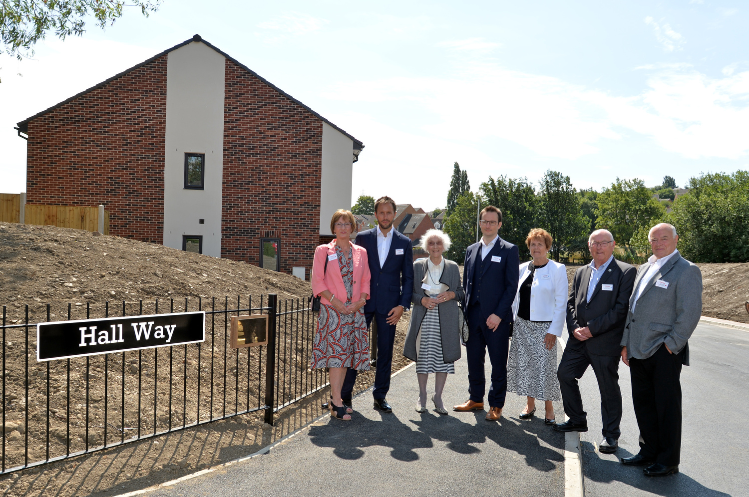The Hall family with the commemorative plaque and street sign in honour of Graham Hall.