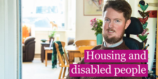 "A man in a wheelchair smiles towards camera. Caption reads ""Housing and disabled people"""